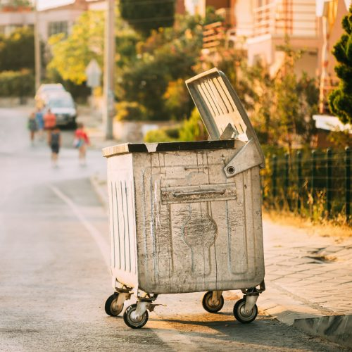metal-waste-container-on-wheels-in-street-during-s-ZRPPFZB (1)